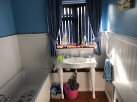 Traditional Bathroom console basin with taps and legs
