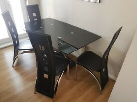 Stylish Glass Dining Table With 4 Chairs