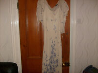A SELECTION OF USED LADIES AND CHILDRENS CLOTHING