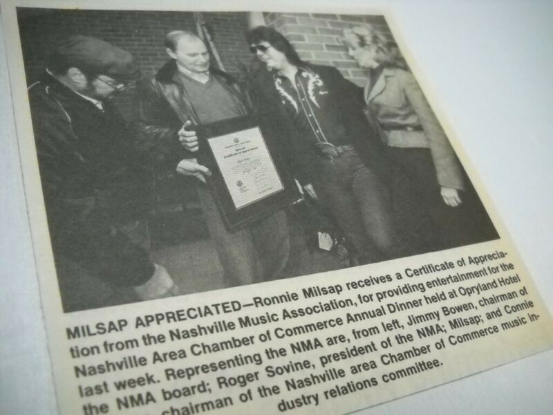 RONNIE MILSAP receives Certificate as execs look on 1975 music biz promo pic/txt