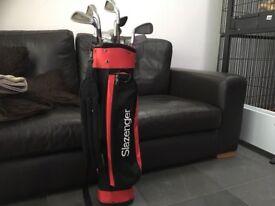 Junior set of 13 golf clubs in red slazenger golf bag