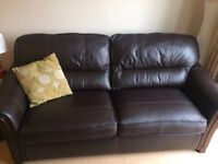 DFS 3 seater brown leather sofa with metal frame fold out bed