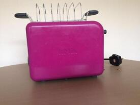 Bright pink kenwood toaster with box