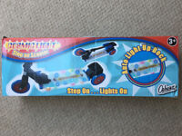 NEW and un-used in original box. Ozbozz Cosmic Light 3-wheel Step on Scooter. £15
