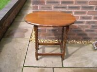 An attractive oval top oak table.