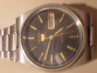 gents Seiko 5 black face automatic watch with day/ date window no 942191