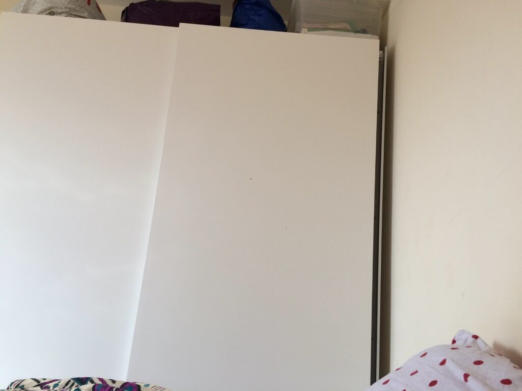 white ikea wardrobe with double sliding doors in bedford