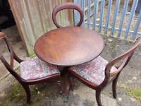 Antique round table and 3 Balloon back chairs