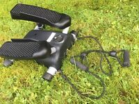 Stepper exerciser with resistance bands