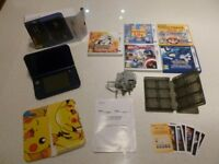 Metallic Blue boxed Nintendo 3DS XL with 5 games & adaptor.