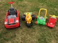 Toddler vehicles including red mini, motorbike, ride on and Walker