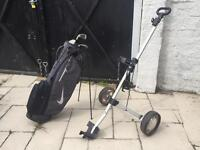 Golf bag, trolley and two clubs