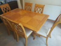 Extending wooden inlaid detail dining table with 6 chairs. Can seat up to 12.
