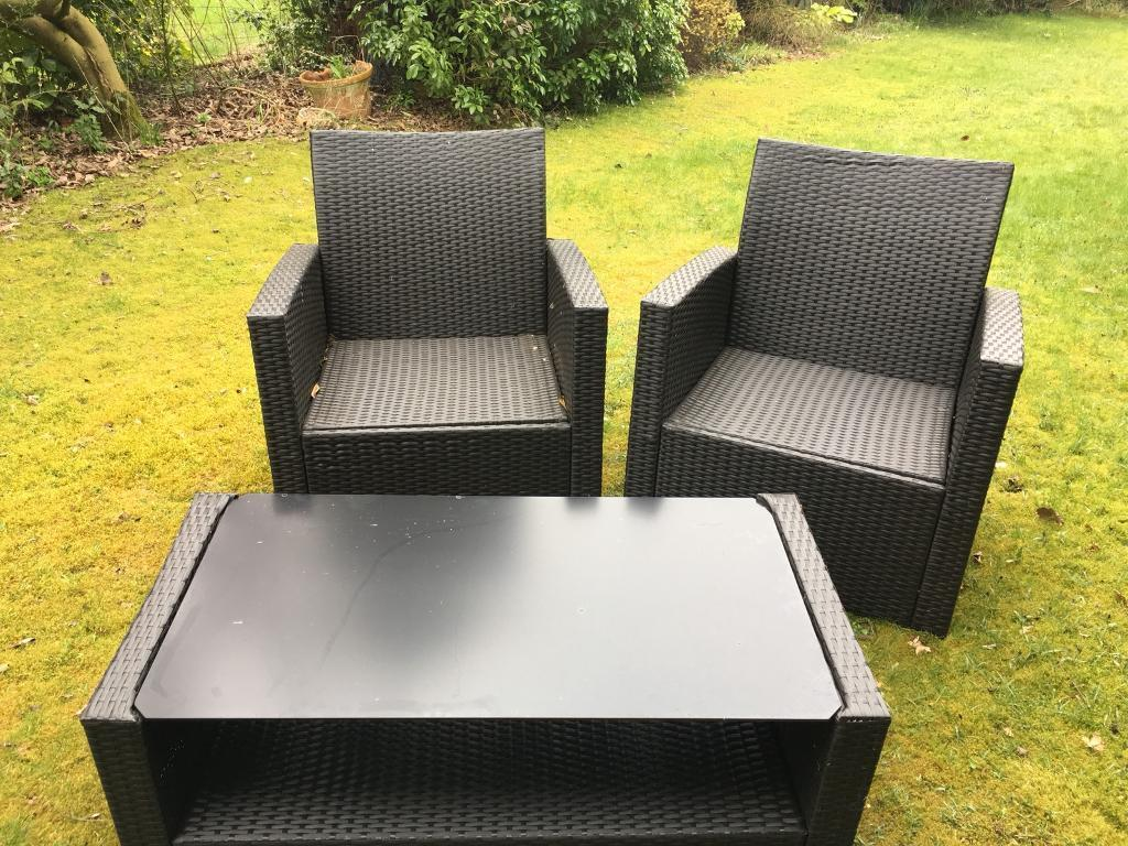 Black wicker outdoor chairs and table