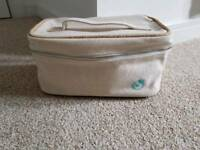 Liz Earle toiletries bag in cream