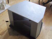 TV Video & DVD stand. Black base, light grey cabinet, smoke glass door