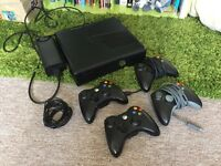 Xbox 360 black with Kinect, 16 games and Xrocker chair.