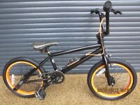 CHILDS BLANC QUALITY BMX. IN EXCELLENT ALMOST NEW CONDITION, (IDEAL PRESENT).. SUIT AGE. 7+..