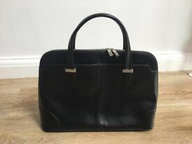Knomo black leather ladies briefcase with pink lining