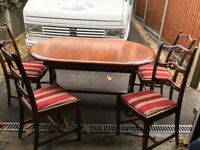 Lovely solid wood table and 4 chairs table top is unmarked
