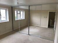 4 mirrored sliding wardrobe doors plus rails