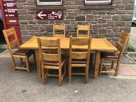 Halo solid oak extending dining table & 6 leather padded chairs * free furniture delivery*