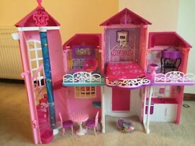 Large pink doll house