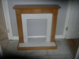 small fire surround with backing