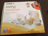 Medela swing single electric breast pump with extra bottles