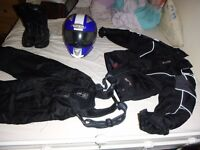 size 8/10 women motor bike gear waterproof, trousers, jacket, size 5 boots, and a blue helmet