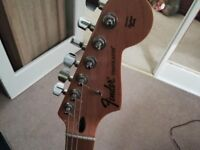 Metallic blue fender Mexican stratocaster guitar comes with case