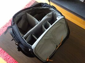 Lowepro padded camera bag with waterproof cover.