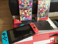 Nintendo switch (boxed) blue and red controllers