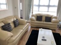 2 x 2 seat Cream Leather sofas. Very Good Condition.