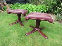 Two Scandinavian luxury leather foot stools
