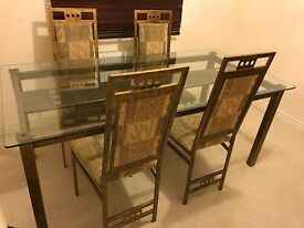 good condition metal and glass dining room table and six chairs
