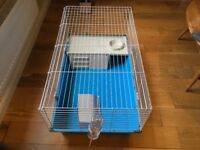 A large indoor rabbit/guinea pig cage as new. 95cm X 55cm X 45cm