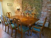 Light mahogany dining room table and chairs for 8