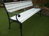 A heavy cast iron and timber garden bench
