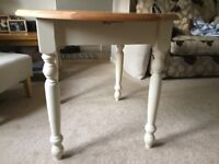 dining table with cream skirt and farmhouse legs,extendable,seats up to 6