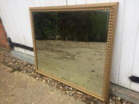 Large Bevelled Edge Gold Framed heavy Overmantel Mirror has scratch