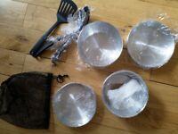 Unused camping pots and utensils
