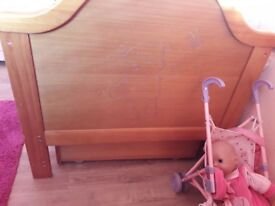 Wooden cot bed with drawer
