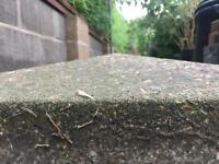 Pair of weathered coping stones for brick piers