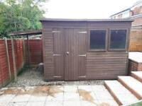 Garden shed with lean-to