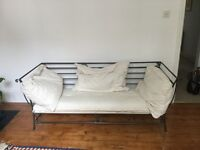 Cast iron sofa with futon base and 3 large cushions. Beautiful in living, bedroom and conservatory