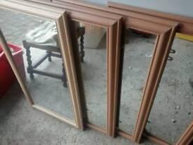 Four rectangular wooden mirrors