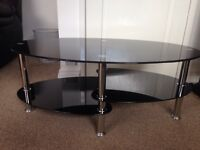 Smoked glass coffee table and matching TV unit.