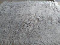 Grey fur rug