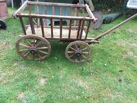 Original four wheel cart ...perfect in a garden setting